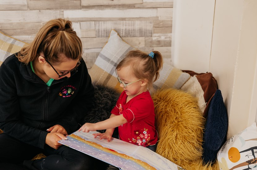 Staff reading with child